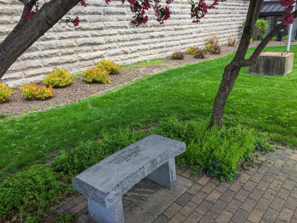 Spearheaded by the former county recorder and funded entirely by donations, this bench in memory of Don Conlon sits outside the Dubuque County Courthouse today.